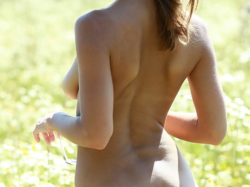 Blonde with huge areolas naked in a field