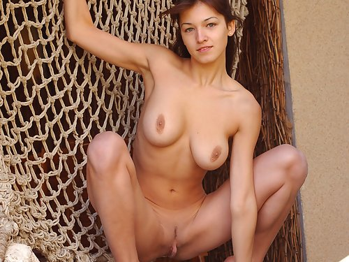 Perfect busty brunette posing naked