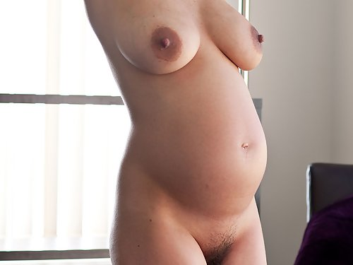 Pregnant brunette with big tits and big dark nipples