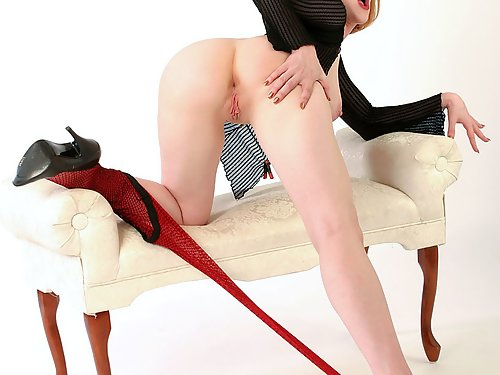 Redhead in fishnet pantyhose spreads