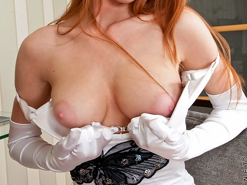 Horny redhead toying her hairy pussy