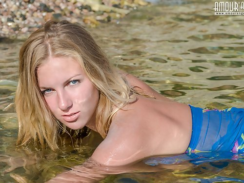 Stunning blonde with huge areolas naked in the sea