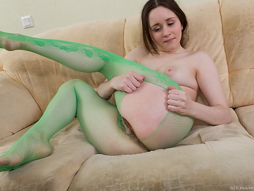 Hairy brunette with pale skin in mesh pantyhose
