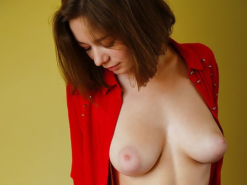 Shaved brunette with torpedo tits in stockings