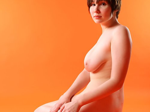Busty short-haired brunette with pale skin