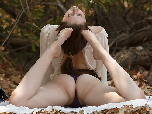 Brunette amateur with big areolas in a forest