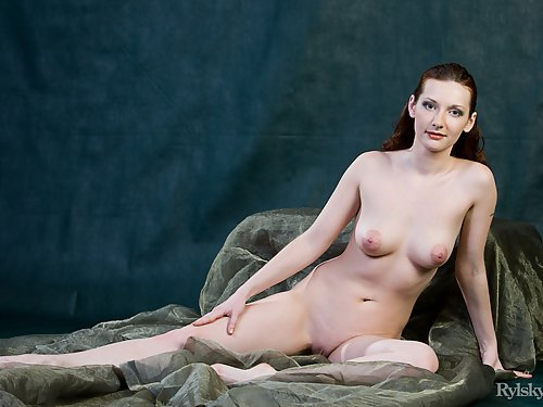 Freckled redhead with big areolas posing nude