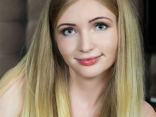 Shaved blonde teen with puffy nipples and pale skin