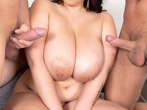 Chubby black-haired busty girl fucked by 2 guys