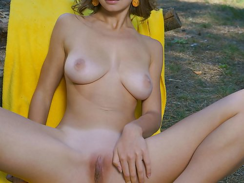 Shaved girl with torpedo tits nude by a forest