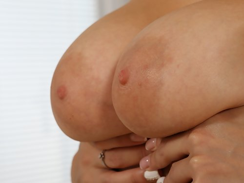 Busty blonde with large areolas toying
