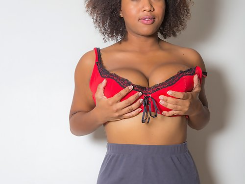 Chubby black girl shows off her big tits
