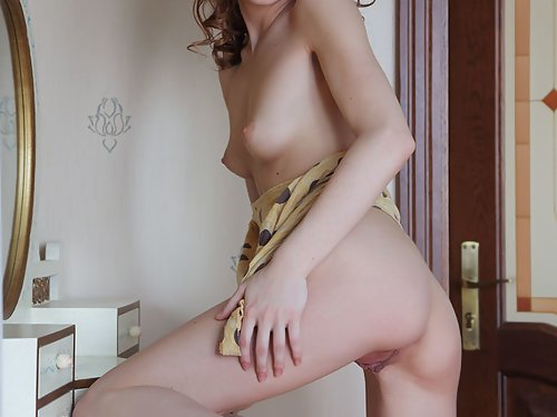 Skinny brunette with meaty pussy lips