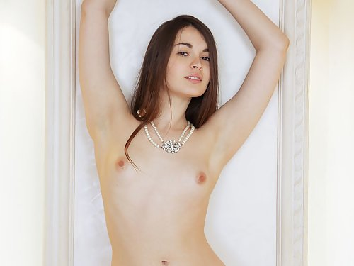 Freckled brunette with big puffy nipples masturbating in bed
