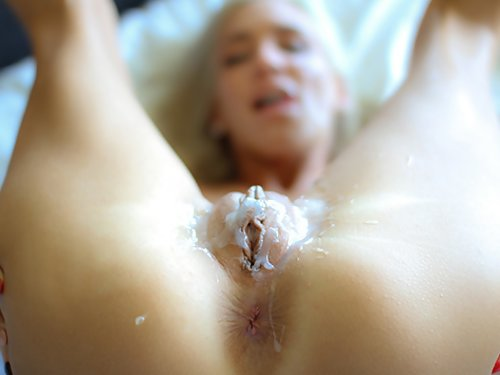 Flat-chested blonde with big pussy lips fucked and covered in cum