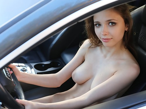 Busty brunette Mila Azul spreads her shaved pussy by a car