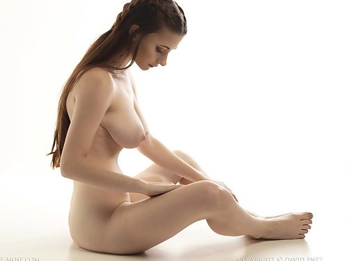 Long-haired brunette with tits and saucer nipples posing nude