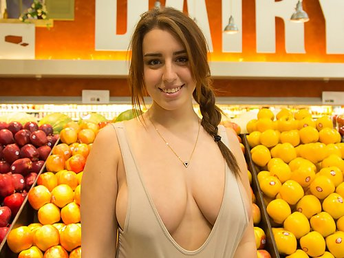 Curvy brunette flashes her big boobs in a grocery store