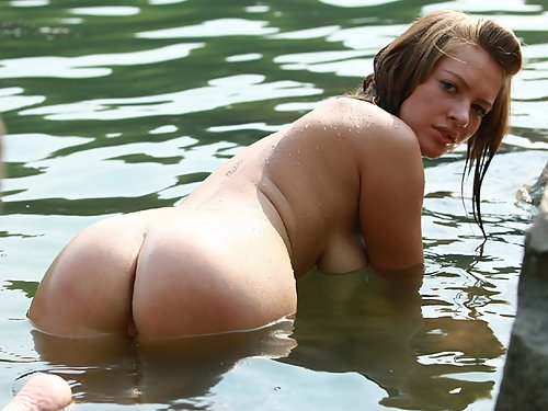 Busty Russian girl with large areolas nude in a lake