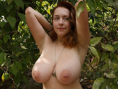 Chubby freckled redhead shows off her huge tits outdoors