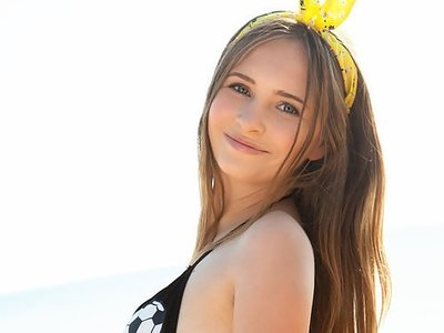 Cute brunette teen takes off her bikini