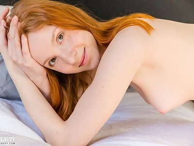 Freckled redhead shows off her meaty pussy lips