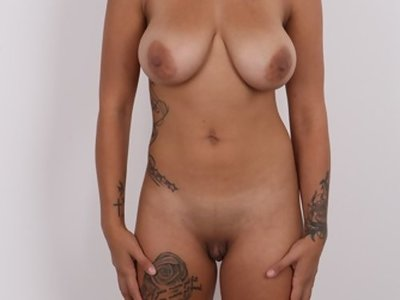 Casting pics of a tattooed busty girl with big pussy lips