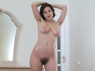 Hairy brunette with large areolas oils up her body