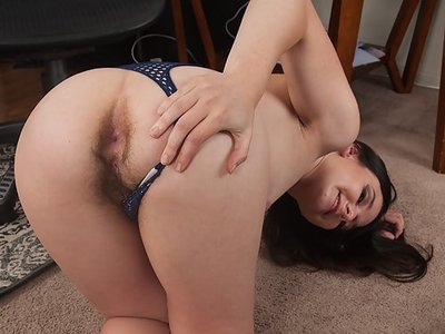 Hairy brunette pulls her thong aside and spreads her wet pussy