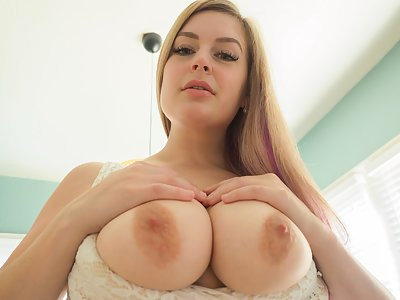 Chubby blonde with big tits spreads her holes