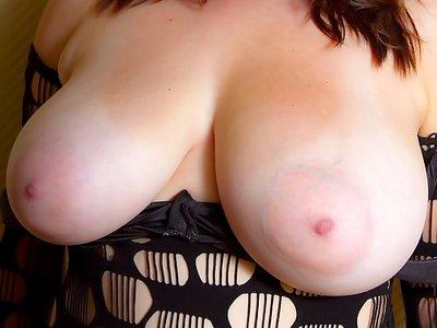 Amateur flashes her enormous tits