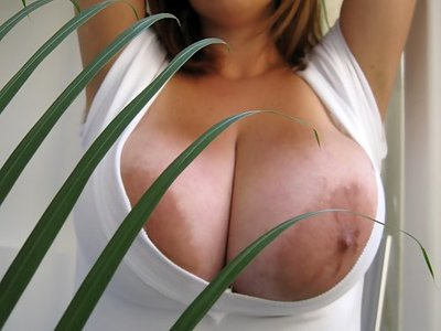 Busty brunette Eden Mor shows off her huge tits and massive areolas