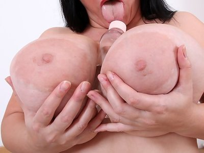 Chubby mature lady shows off her huge pancake areolas