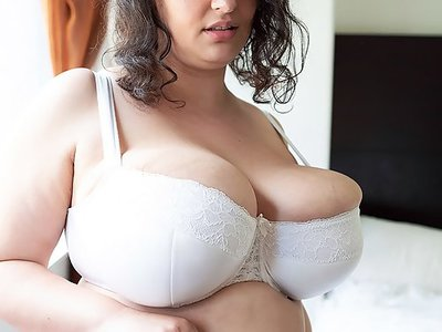 Chubby brunette with huge veiny tits toying in bed
