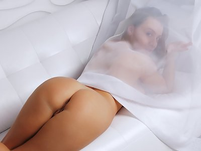 Busty girl pulls her panties aside in bed