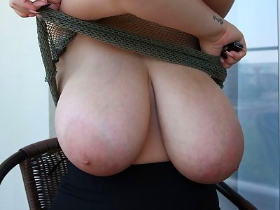 Chubby girl shows off her massive titties