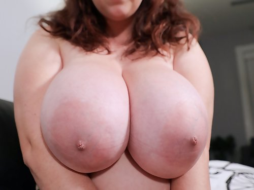 Chubby brunette Milly Marks shows off her huge tits