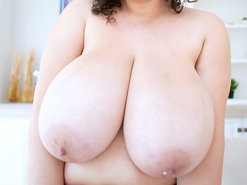 Chubby brunette with huge veiny boobs spreads her shaved pussy