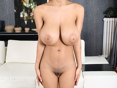 Petite black girl shows off her enormous titties