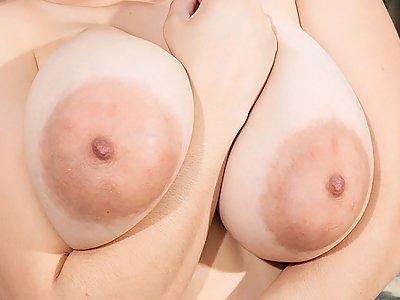 Sexy Latina with huge saucer nipples