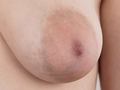 Casting pics of a black-haired amateur with saucer areolas