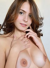 Gorgeous brunette with big tits spreading in bed