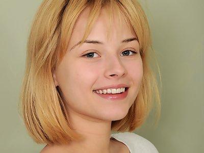 Busty blonde teen spreading in bed