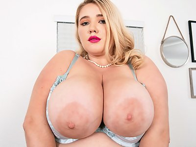Chubby blonde with saucer nipples toying her shaved pussy