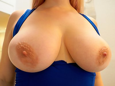 Chubby busty blonde lifts up her dress and spreads her holes
