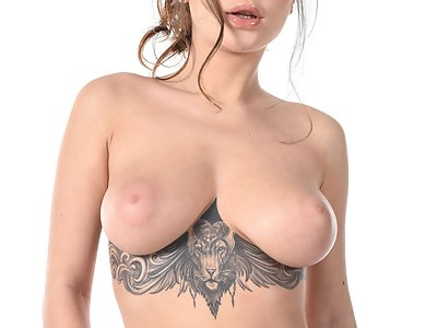 tattooed brunette Liya Silver shows off her big firm tits