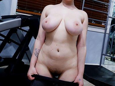 Curvy redhead with big tits stripping