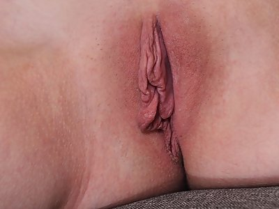 Shaved blonde with large pussy lips posing nude