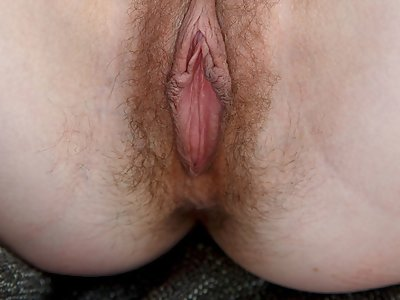 Hairy brunette shows off her big pussy lips