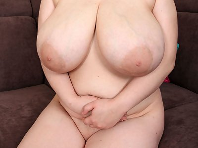 Chubby black-haired girl shows off her huge veiny tits